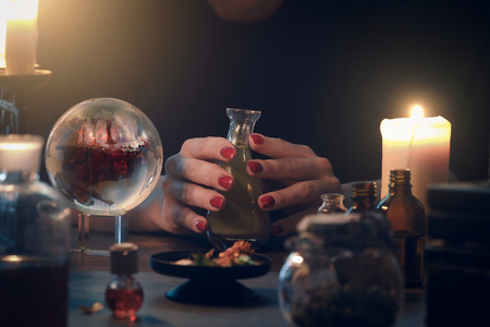 Witchcraft. The hands of witches, magic ball Stock Photo