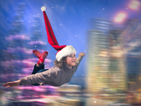 Beautiful girl flying in the new cap. Background - the speed, the city at night. The concept of Christmas sales, new year discounts, big possibilities Stok Fotoğraf