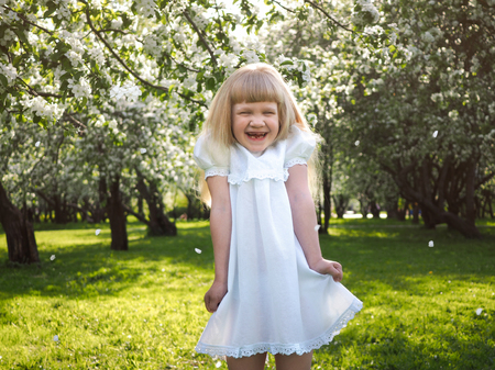 Very emotional portrait of a little girl. Funny child laughs happily