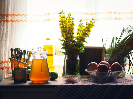 Table by the window with the usual village products and household items. Natural still life Banque d'images - 115398523