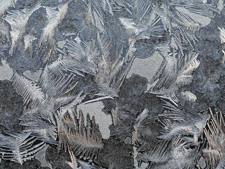 Frosty patterns on the window glass. Beautifully frozen ice