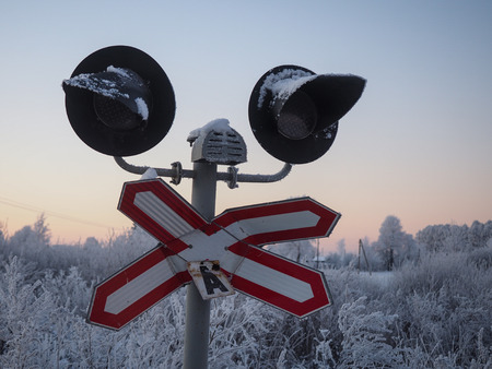 Broken railway traffic lights. The danger at the crossing of the railway