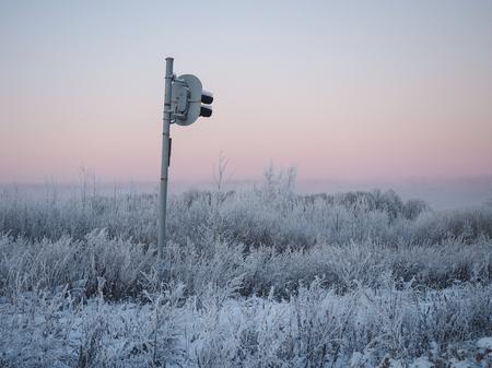Strange railway traffic lights in icy field Stock Photo