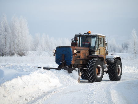 Tver region. Sonkovsky district. Russia. 28 January 2019. Clearing snow from the road. Tractor grader clears snow from the road. Stock Photo