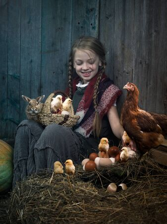 Rural Easter scRural Easter scene with a child, chickens and a rabbitene with a child, chickens and a rabbit Stock Photo - 137646836