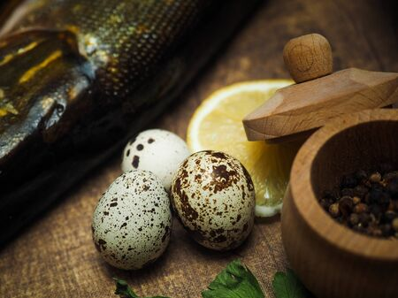 Ingredients for cooking close-up. Quail eggs, lemon 스톡 콘텐츠