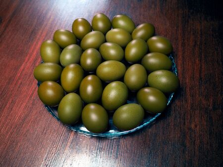 Beautiful green Easter eggs on the table 스톡 콘텐츠