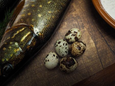 Fresh fish, quail eggs. Ingredients for cooking delicious and healthy food