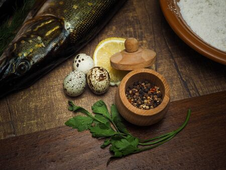 Fresh pike, quail eggs, seasonings. Ingredients for cooking healthy and delicious food