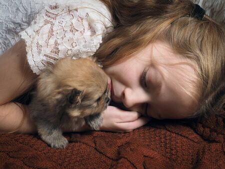 The girl fell asleep hugging the puppy. The story of a dogs friendship with a child