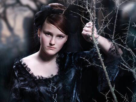 Mystical portrait of a young girl in black