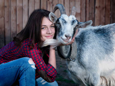 Portrait of a girl with a goat Banque d'images