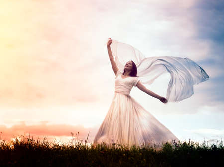 Girl in a dress in the field. The concept of freedom, women's health, and greater opportunities