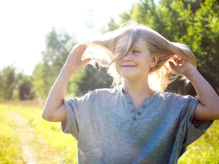 Happy child in nature. Portrait of a girl Banque d'images
