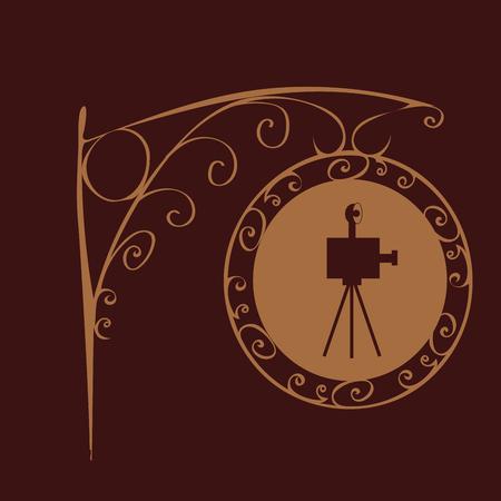 advertising column: Retro cinema sign. Film camera silhouette. Showing retro films Illustration