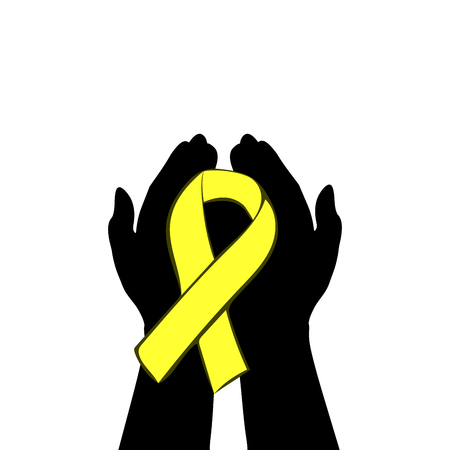 Hands hold with yellow ribbon. World childhood cancer day