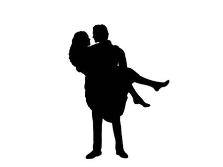 Silhouette of a man holding a woman in her arms looking at each other