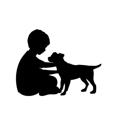 Silhouette little boy hugs dog puppy