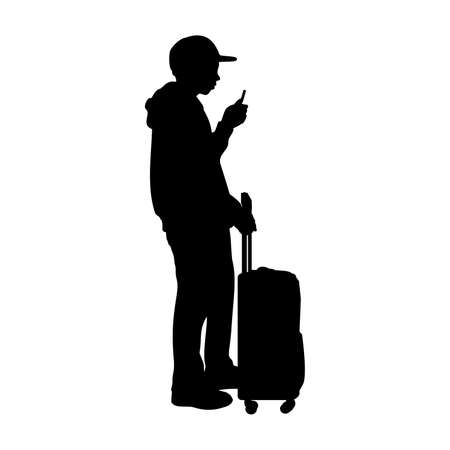 Silhouette teenager boy standing with suitcase
