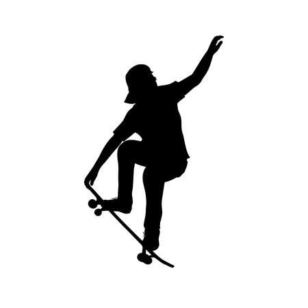 Silhouette of teenage skateboarder doing trick on skateboard
