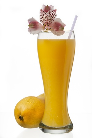 glass of mango juice and decorated with flowers photo