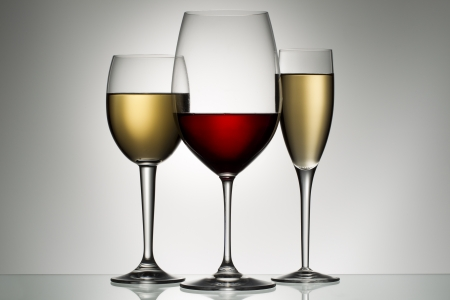 white wine bottle: glasses of red and white wine Stock Photo