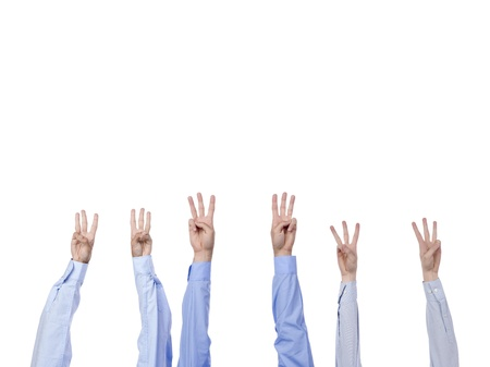 Business team with arm in air signaling success Stock Photo - 15291489