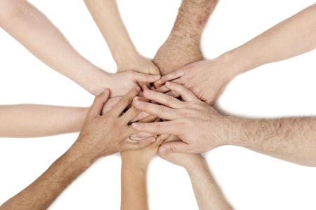 A diverse group of business workers with their hands together in form of teamwork and unity Stock Photo - 15378948