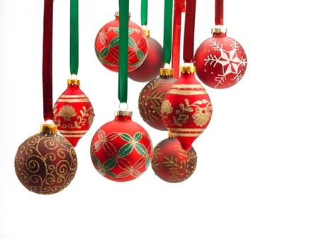 Close-up of christmas baubles hanging over white background. Stock fotó