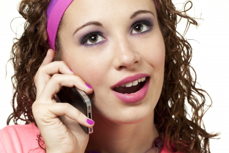 headband: Young lady dressed in neon talks on the phone. Makeup by Irene Prowell - professional freelance makeup artist. Stock Photo