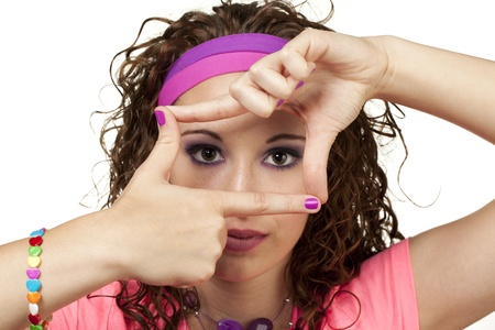 Younge girl looks through her fingers at camera. Makeup by Irene Prowell - professional freelance makeup artist. Stock Photo - 15600290