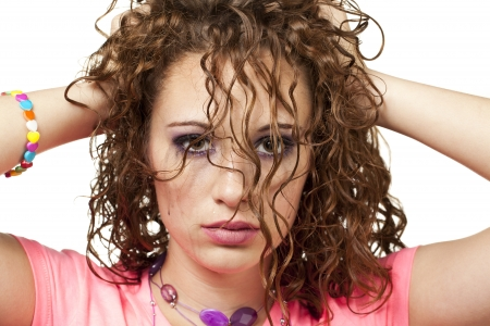 Straight shot of young woman playing with her hair. Makeup by Irene Prowell - professional freelance makeup artist. Stock Photo - 15600294
