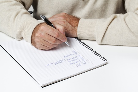 Mid section image of a businessman writing. Stock Photo - 15543178