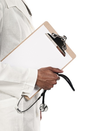 cropped shots: Mid section of a doctor holding clipboard and stethoscope over white background, Model: Kareem Duhaney
