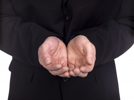 lend a hand: Closed up shot of an open palm of a man wearing a black long sleeve suit
