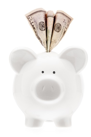 Piggy bank with money inserted into slot Stock Photo - 15543089