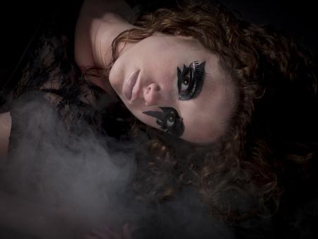amanda: Gothic woman laying in fog