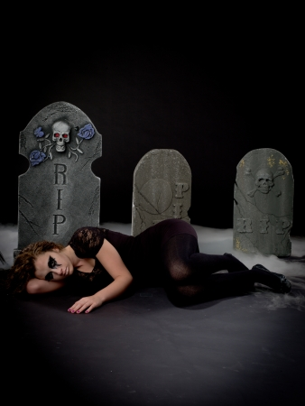 Gothic girl laying in graveyard- MUA  Amanda Wynne - www awynnemakeup com photo
