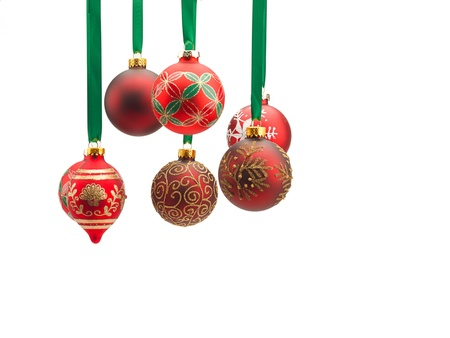 Christmas baubles hanging over white background.