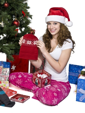 Portrait of a smiling young woman showing het Christmas present, Model  Brittany Beaudoin Stock Photo - 15615817