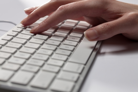 Cropped close-up image of a human hand on computer keyboard. Stock Photo - 15839813