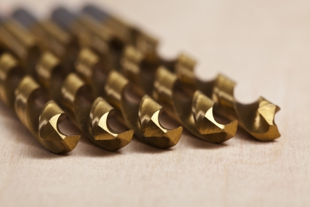 Macro image of Drill bits over a wooden background Stock Photo - 15839680