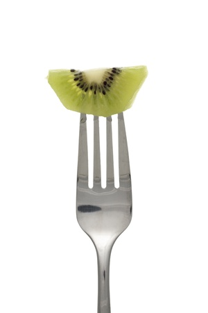 Close-up shot of kiwi fruit on fork against white background. Stock Photo - 15836920