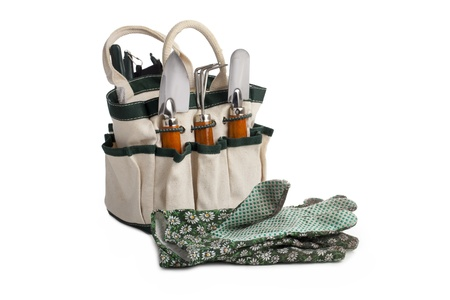 Gardening tool bag with tools and pair of gloves Stock Photo