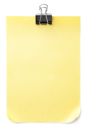 Close-up image of black paper clip on yellow note. Stock Photo - 15840091