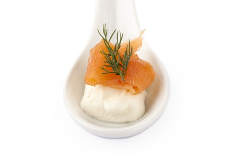 blini: A healthy smoked salmon on a ladle with blini on the top