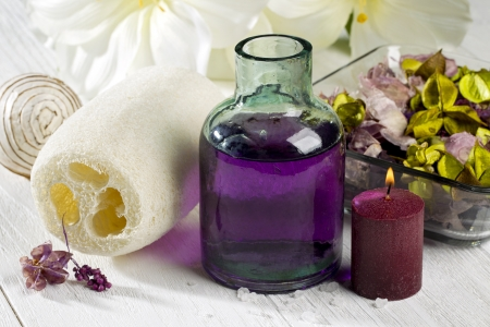 objec: A spa treatment with oil, candle and flower on a white wood Stock Photo