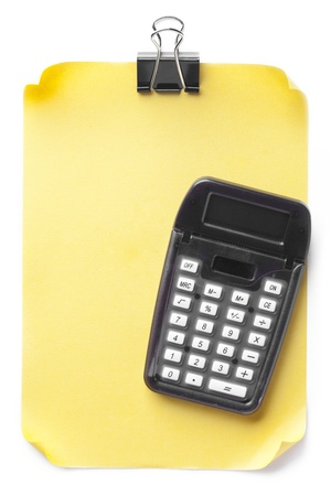 Yellow sheet and calculator on a white background Stock Photo - 15851283