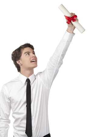 doctorate: Portrait of proud male student raising his diploma over the white background