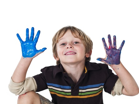 Happy blonde boy with painted hands over white background,